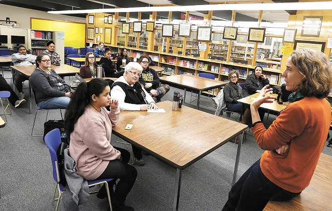 UW anthropology professor Holly Barker, right, talks about the legacy of U.S. nuclear testing at Shaw Middle School. - YOUNG KWAK