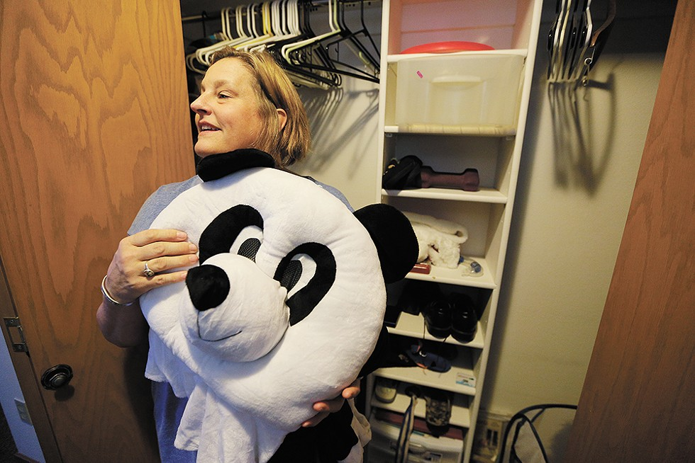 Ami Strahan with Sam's panda onesie, something he joked about wanting to wear to school, with the head, to see if anyone could recognize him. - YOUNG KWAK