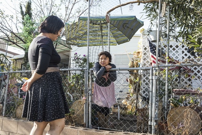 Veronica Lagunas, from El Salvador, and her daughter Angie, 8, at their home in Sylmar, Calif., Dec. 31, 2017. Lagunas is one of nearly 200,000 people from El Salvador who, after being allowed to live in the U.S. for more than a decade, must leave the country because the Trump administration is reportedly ending a humanitarian program, known as Temporary Protected Status. - EMILY BERL/THE NEW YORK TIMES