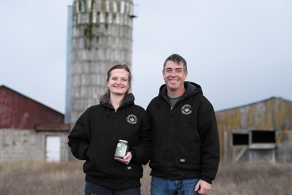 Pot farmers Crystal and Kevin Oliver worry about new fees from the regional Clean Air Agency. - HECTOR AIZON