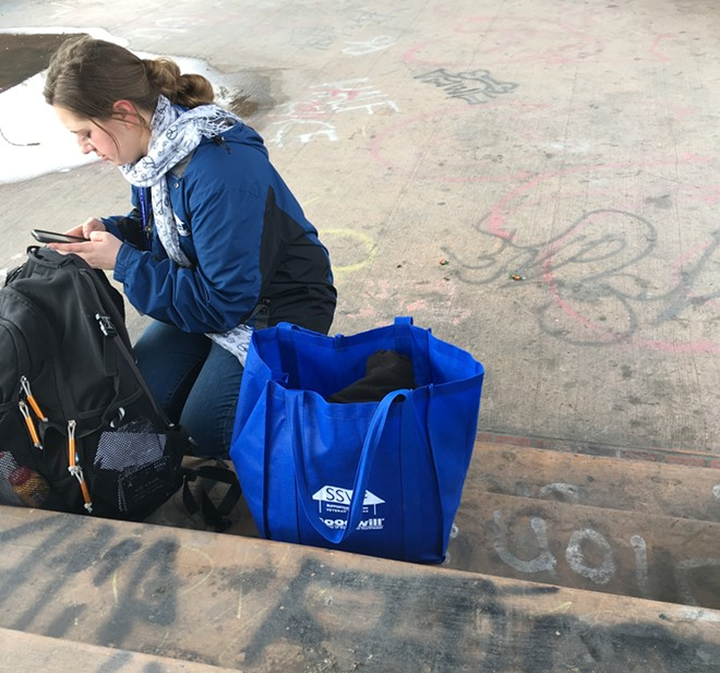 "Cailin Carpenter, outreach lead for the SSVF program for Goodwill Industries of the Inland Northwest, helps survey people experiencing homelessness for the city's annual ""point-in-time count,"" which aims to get a snapshot of where people are sleeping in the city, and what is affecting their lives and ability to find housing. - SAMANTHA WOHLFEIL PHOTO"