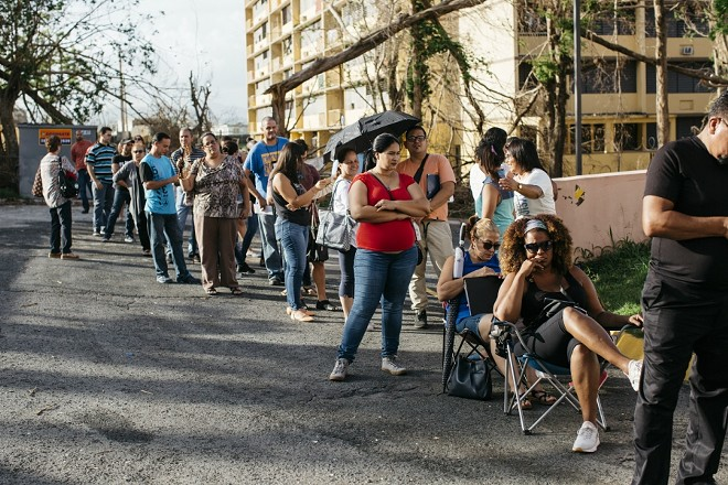 A line stretches outside the unemployment office in Bayamon, Puerto Rico, Oct. 23, 2017. For most Puerto Ricans, the catastrophe of Hurricane Maria has been followed by an economic disaster with no end in sight. - ERIKA P. RODRIGUEZ/THE NEW YORK TIMES