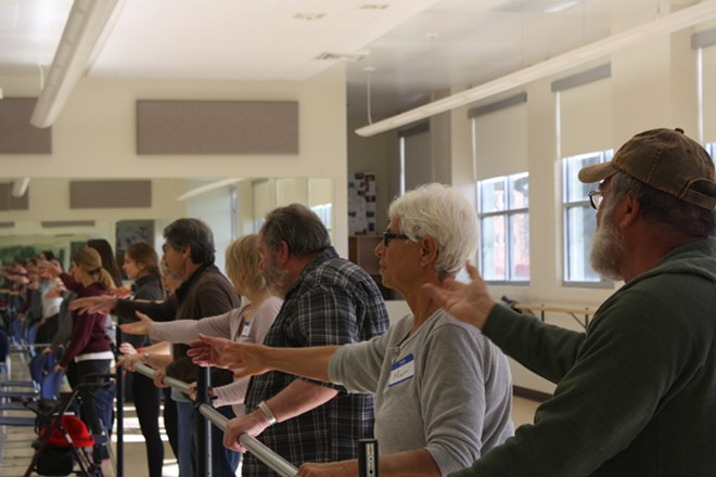 Gonzaga students and Spokane community members participate in a Dance for Parkinson's class at Gonzaga's dance studio Saturday, Feb. 10. - SAMANTHA WOHLFEIL PHOTO