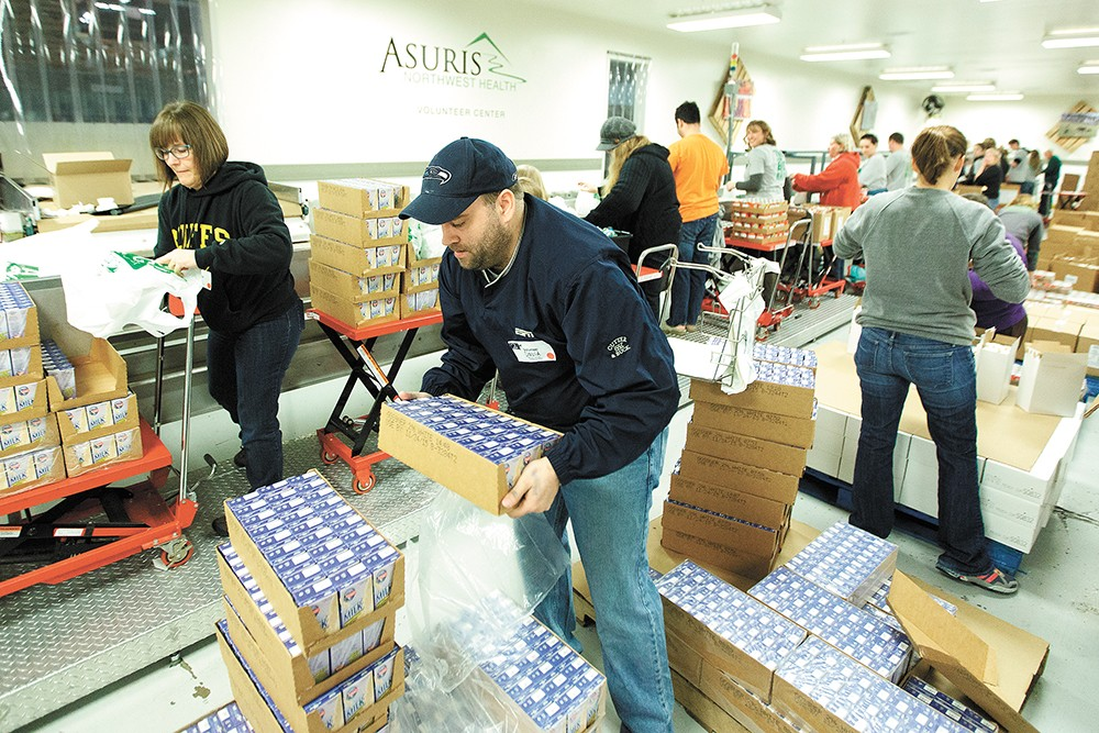 Volunteers sort food at Second Harvest