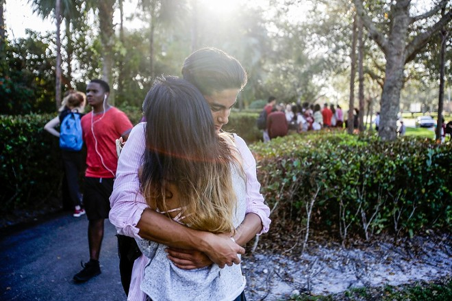 Lavinia Zapata embraces her son, Jorge, after a mass shooting at the Marjory Stoneman Douglas High School in Parkland, Fla., Feb. 14, 2018. On Wednesday, Feb. 28, students were making an emotional return to the classroom. - SAUL MARTINEZ/THE NEW YORK TIMES