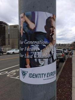 Similar Identity Evropa posters have been posted at local college campuses. - STEPHEN PURDUE PHOTO