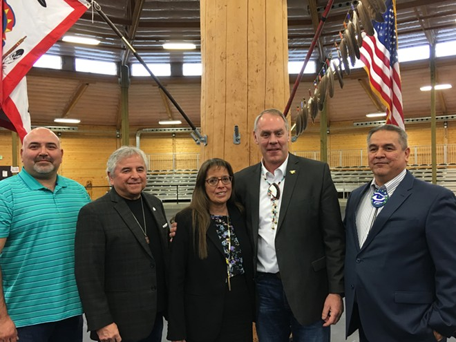 U.S. Interior Secretary Ryan Zinke, second from right, poses with Spokane Tribe Chairwoman Carol Evans and members of the tribe's business council Thursday morning, March 22 after meeting to discuss Grand Coulee Dam reparations and ways to address the nationwide opioid crisis. - SAMANTHA WOHLFEIL PHOTO