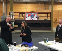 Spokane Tribal Chairwoman Carol Evans presents U.S. Secretary of the Interior Ryan Zinke with gifts of jerky and her homemade huckleberry jam, as well as a dog-tag with a stamped reminder to uphold his duty to the tribe under an executive order from 1881, which established the tribe's reservation. - SAMANTHA WOHLFEIL PHOTO