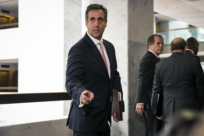 Michael Cohen, President Donald Trump's longtime personal lawyer, speaks to reporters after a closed-door meeting with the Senate Intelligence Committee in Washington on Sept. 19, 2017. The FBI raided Cohen's office on Monday, April 9, 2018, seizing records related to several topics including payments to a pornographic-film actress. - AL DRAGO/THE NEW YORK TIMES