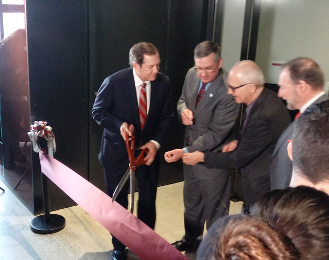 From left: Jordan Schnitzer, WSU President Kirk Schulz and museum architect Jim Olson see how many guys can hold one pair of scissors. - DAN NAILEN