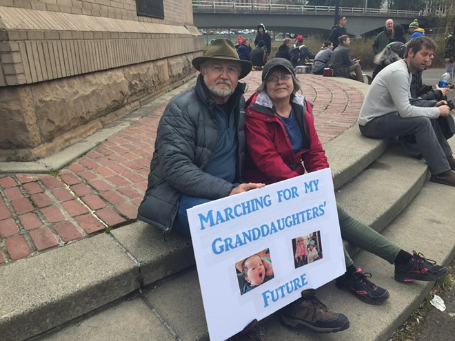 Jim and Beatrice Harrison attend the March for Science in Spokane with the hopes of creating a more environmentally healthy world for their three grandchildren to grow up in. - ERIC SCHUCHT