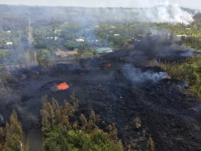 A photo provided by the U.S. Geological Survey shows a volcanic fissure, called fissure seven, in Leilani Estates, near Pahoa, Hawaii, May 5, 2018. More than two dozen homes have been destroyed since the Kilauea volcano began erupting last week, officials said on Sunday, as at least 10 fissures emerged, spewing lava into residential neighborhoods on the eastern edge of the island of Hawaii. - U.S. GEOLOGICAL SURVEY VIA THE NEW YORK TIMES