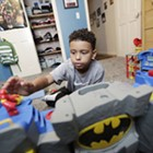 Separated by Drugs: For a 7-year-old boy who lost his parents, signs of trauma linger as he embarks on a new life