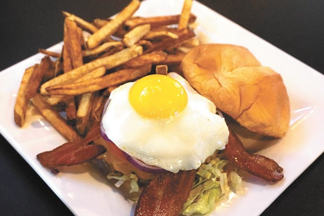 24 Taps' Royal burger, topped with a runny egg.