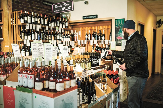 """We don't sell anything at Vino! unless we taste it and approve it,"" owner John Allen says. - JENNIFER DEBARROS"