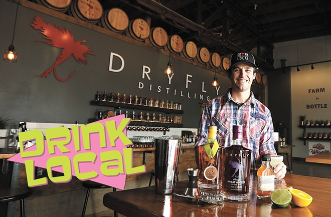Dry Fly's Tasting Room Manager Mike Lenox and some of their award-winning booze. - YOUNG KWAK