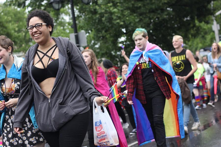 Marchers parade down Spokane Falls Boulevard on Saturday, June 9. - QUINN WELSCH PHOTO