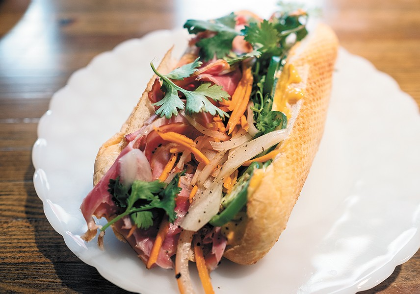 Next Door chef/owner Lindsey Blair's banh mi sandwich. - HECTOR AIZON PHOTO
