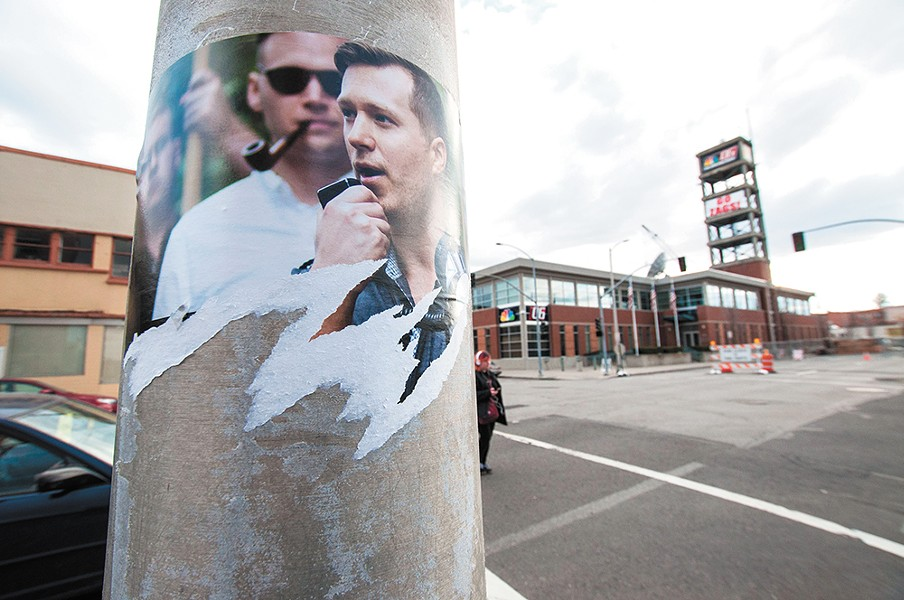 Identity Evropa propaganda posters were swiftly torn down after they were posted in downtown Spokane in March. - DANIEL WALTERS PHOTO