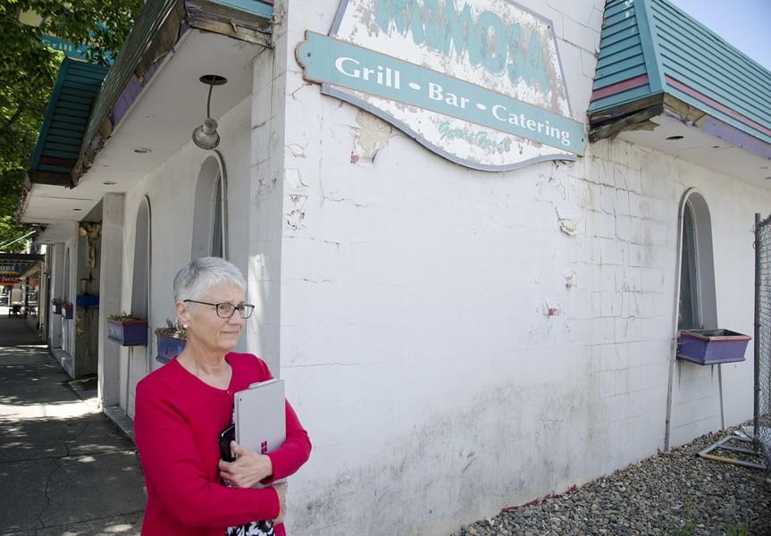 Nancy Swanger, outside the Mimosa building. - JACOB JONES PHOTO