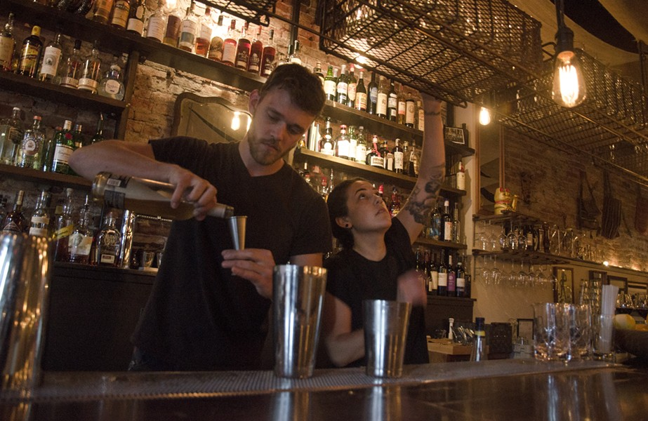 Bartenders Lars Lunstrom and Ariana Barela mix drinks on a recent Thursday evening at the Black Cypress. - JACOB JONES PHOTO