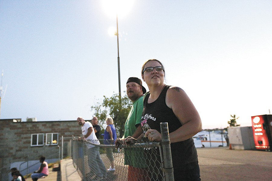 Heather Eller, right, and her husband Cody Eller watch the action on the track. - YOUNG KWAK