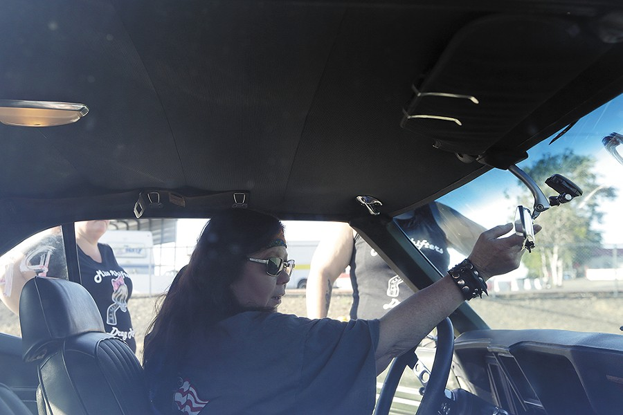 Annette Callesto adjusts the mirror in her 1969 Chevrolet Camaro. - YOUNG KWAK