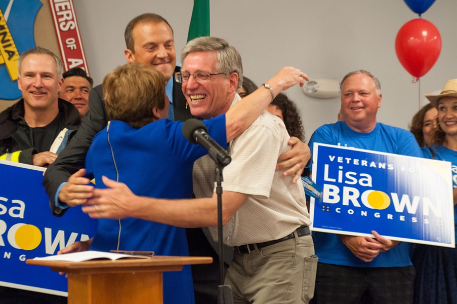 Lisa Brown shares a hug with Washington state Reps. Timm Ormsby and Marcus Recelli. - DANIEL WALTERS PHOTO