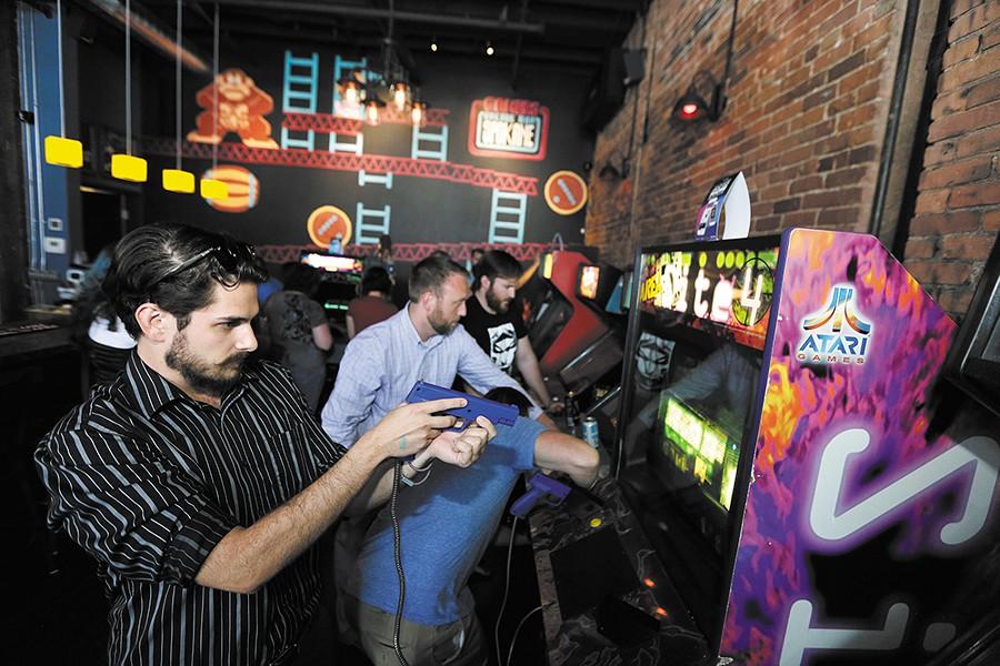 Scott Mailhean takes aim at Gamers Arcade Bar. - YOUNG KWAK