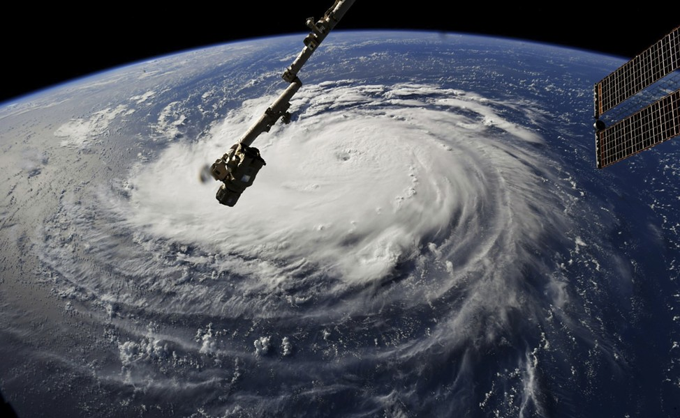 In a photo provided by NASA, Hurricane Florence approaches the east coast of the U.S., Sept. 10, 2018. Evacuations were ordered on coastal islands as the region braced for a destructive storm. - NASA VIA THE NEW YORK TIMES