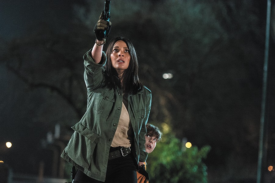 Olivia Munn has proven she can take down predators onscreen and off, but she's underserved in Shane Black's muddled sci-fi sequel.