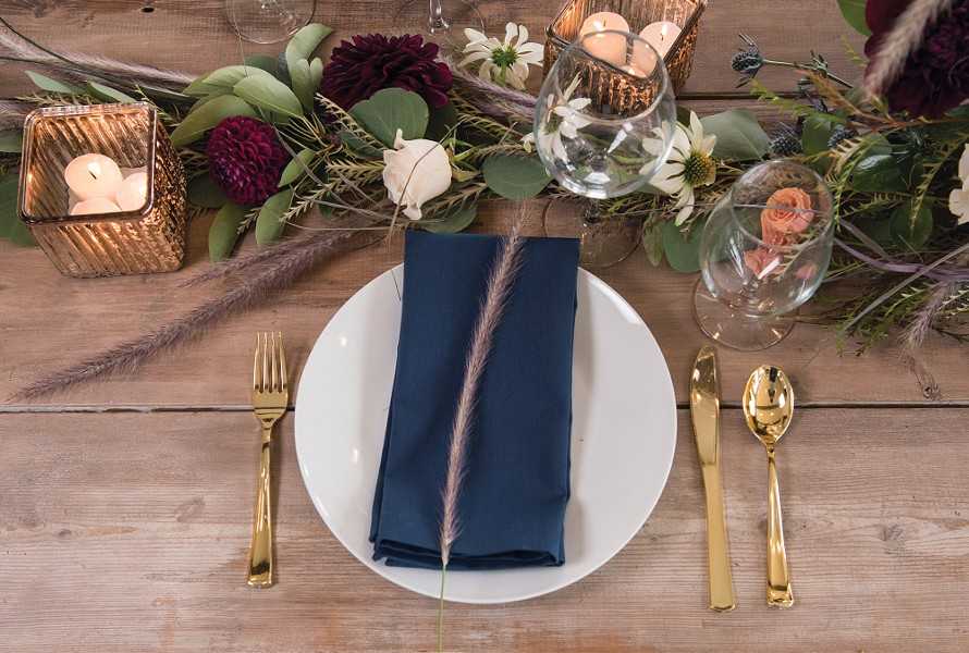 Signer employs basic tableware to make sure flowers get all the attention on this rustic table, which was crafted from salvaged planks by the homeowners Justin and Tarah Gray. - DON HAMILTON PHOTO