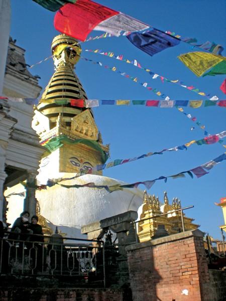 Prayer flags hanging in Nepal - RAEVYN WEST PHOTO