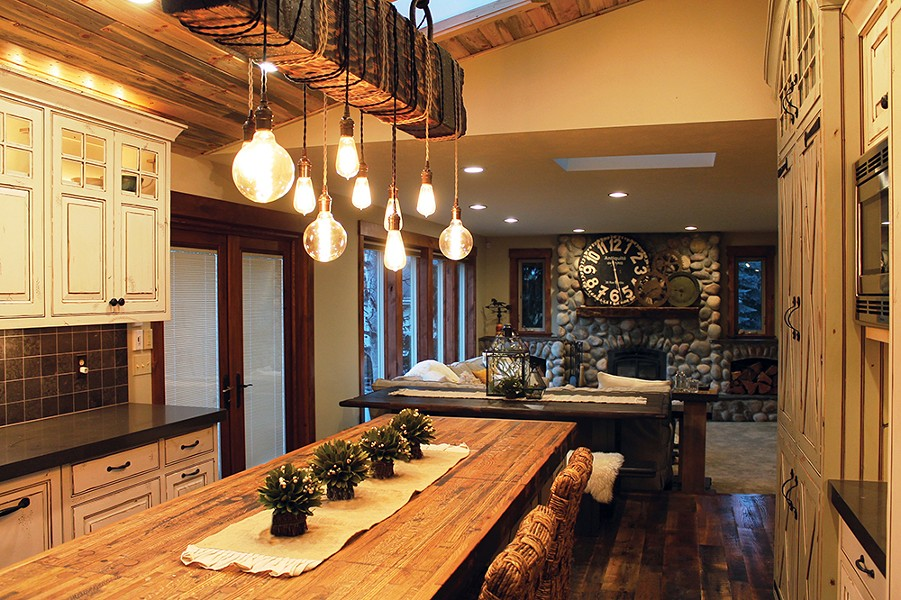 To add a focal point to this kitchen, Shaleesa Mize specified a unique light fixture crafted from reclaimed wood by Spokane's Dare Designs. - SHALEESA MIZE PHOTO