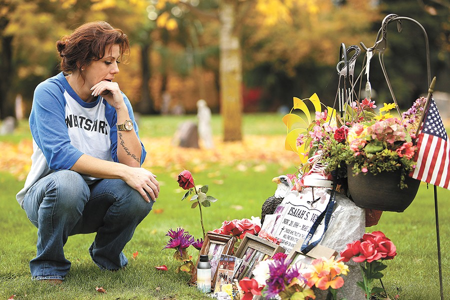 Courtney McKinnie at the gravesite of her son, Isaiah Wall, who died 11 days after he started working as a drug informant. Wall's life and death became the subject of a cover story on Nov. 17, 2016. - YOUNG KWAK