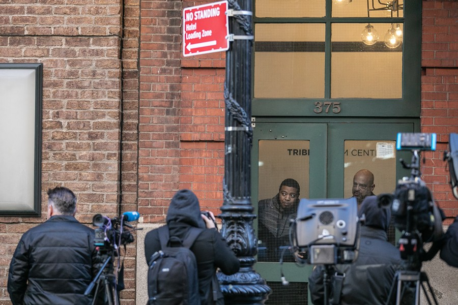 Reporters gathered outside the Tribeca Film Center building, where a suspicious package addressed to actor Robert De Niro was discovered to have contained a pipe bomb and removed by a police bomb squad, in New York, Oct. 25, 2018. Two additional pipe bombs, one addressed to former Vice President Joe Biden and the other, De Niro, were found in Delaware and New York, law enforcement officials said Thursday. - JEENAH MOON/THE NEW YORK TIMES