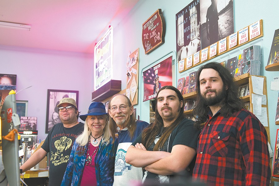 Husband and wife Deon and Terry Borchard (second and third from left) opened the first Long Ear record store in 1973, and they're celebrating its 45th anniversary on Saturday. - DEREK HARRISON