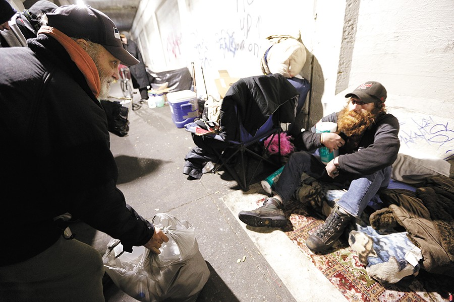 James Welch talks to John, who says he has been homeless for the past five of six months. - YOUNG KWAK