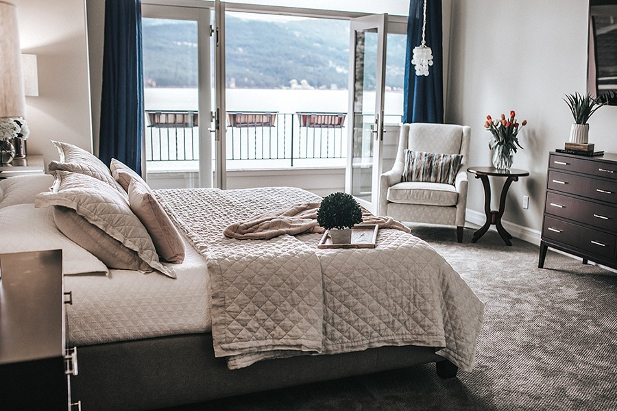 The Wozow master suite features soft colors, with an occasional pop of blue to complement, but not compete with, the sweeping Liberty Lake view. - ALICIA HAUFF PHOTO