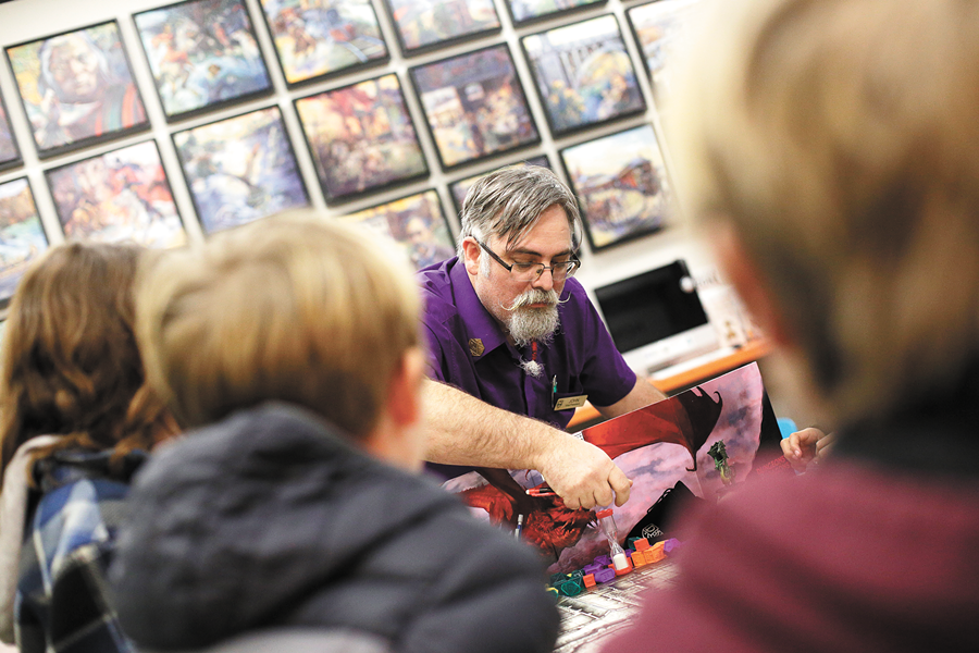 RPG Research Vice President John Welker leads Dungeons & Dragons sessions for kids twice a month at Spark Central in Kendall Yards. - YOUNG KWAK
