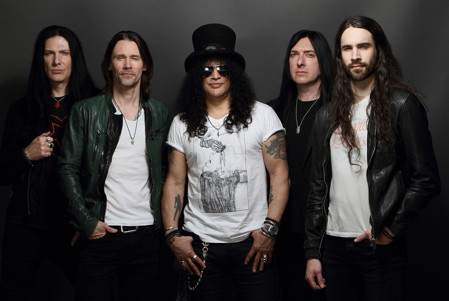 Slash (center) and Myles Kennedy (left center) and the Conspirators