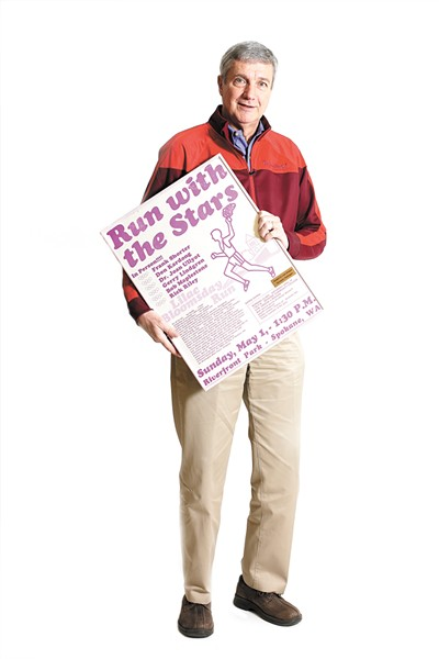 Don Kardong with the poster for the first Lilac Bloomsday Run in 1977. - YOUNG KWAK