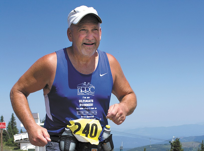 Larry Taylor makes his way up the grueling Mount Spokane section of the Let's Climb a Mountain course. - RON NUTKOWITZ PHOTO