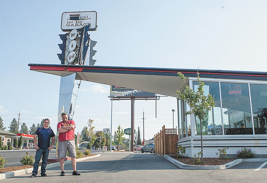 Owners Kevin Pereira (left) and Jhon Goodwin outside of Lost Boys Garage Bar & Grill. - MEGHAN KIRK