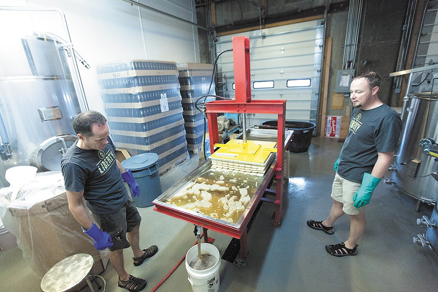 One Tree Cider's co-owner Neal Hennessy with an assortment of ciders. - YOUNG KWAK