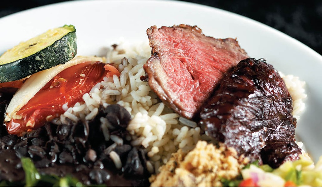 A heaping plate of steak, greens and rice at the Grille from Ipanema. - YOUNG KWAK