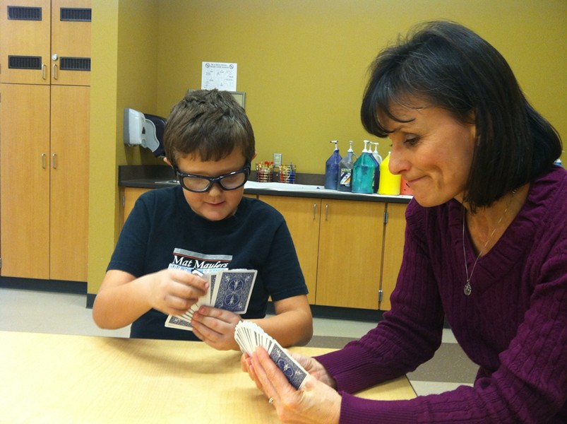 A mentor plays cards with a student at Snowdon Elementary School in the Cheney school district. - COMMUNITIES IN SCHOOLS