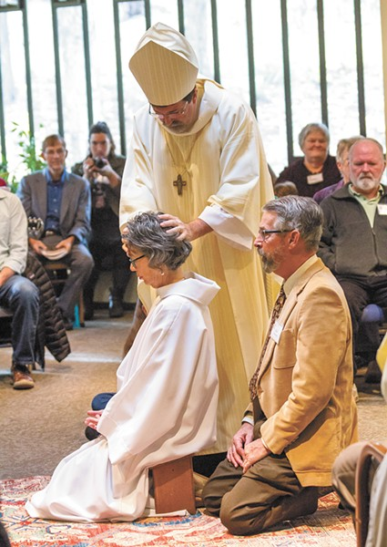 Linda Kobe-Smith, accompanied by her husband, Dan, is the first woman to be ordained as a priest in Spokane, and the second in the entire state. - JEFF FERGUSON