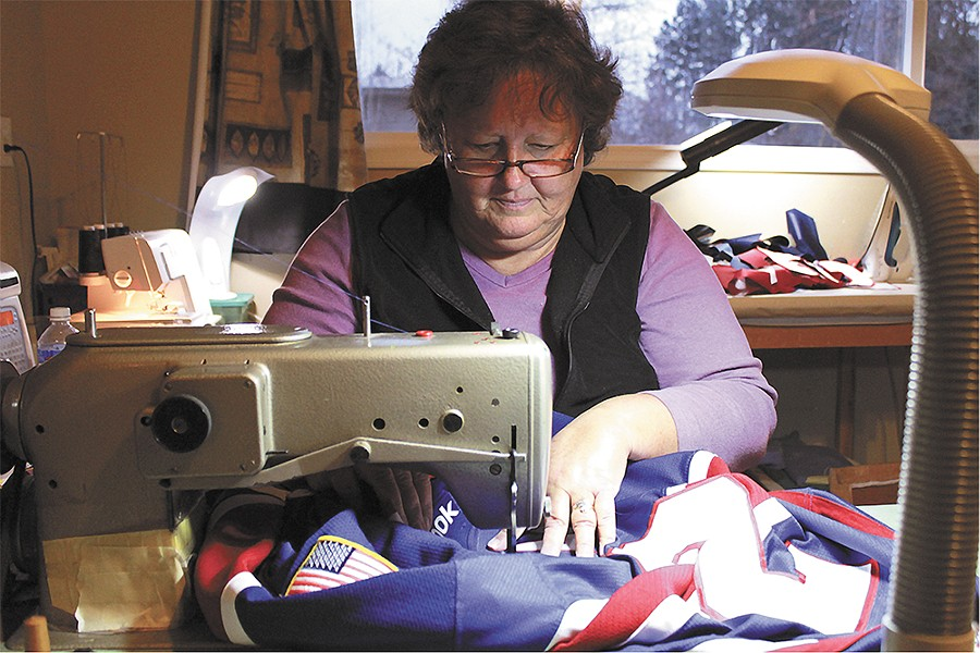 Barbara Parker sews a Spokane Chiefs jersey at her home studio. - QUINN WESTERN