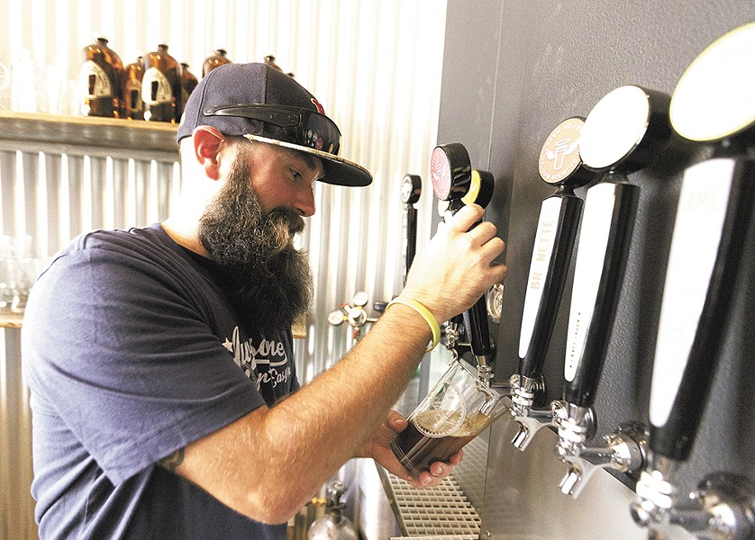 Markus Lowe pours a pint at Orlison's new taproom. - YOUNG KWAK